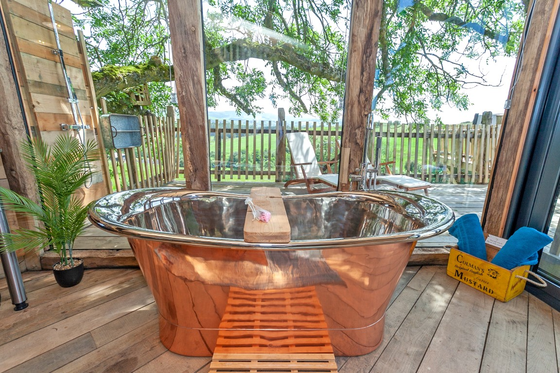 Large copper bath at Cadwollen's Treehouse in Wales