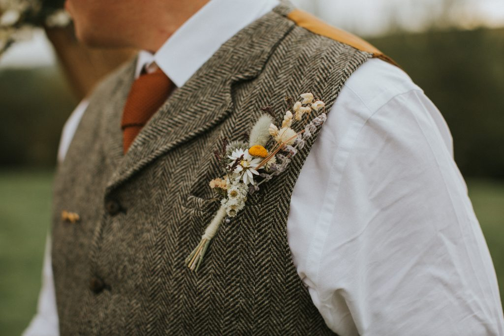 vow renewal with tweed and rustic details