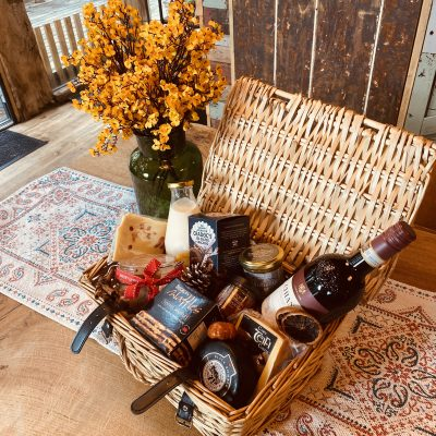 cosy winter hamper with cheese, wine, hot chocolate, crackers